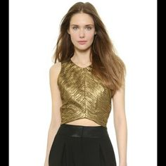 Gorgeous bronze/gold crop top by Ronny KoBo NWT Designer crop top by Ronny Kobo NWT size medium. Would look great with a black leather skirt, high bun and some booties! Color is a beautiful bronze/gold Ronny Kobo Tops Crop Tops