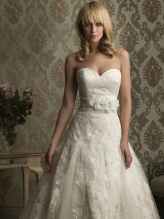 A-line, sweetheart neckline with flowers at natural waist