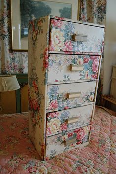 Maybe just the drawers in some lovely fabric. Paint the side of the ghastly file cabinet.