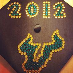 403e0453520 Mortar board decorated by  USF graduate  Julia Pappacoda. Grad Cap