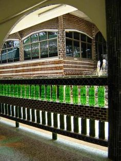 Plastic and Glass Recycling for Fences Built of Empty Bottles 20 Green Building Ideas Building A Fence, Green Building, Building Ideas, Reuse Bottles, Empty Glass Bottles, Custom Kitchen Cabinets, Kitchen Cabinet Design, Plastic Bottle Greenhouse