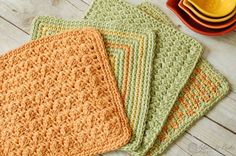 From left to right: Textured Dishcloth,Seeing Squares Dishcloth, Crunchy Stitch Dishcloth, and Three Color Simple Stitch Dishcloth.