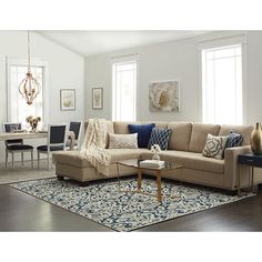 Add ample seating along with a heightened sense of style to your living area with this beige sectional from Abbyson Living. Constructed from kiln-dried solid wood, this furniture piece is durable to w
