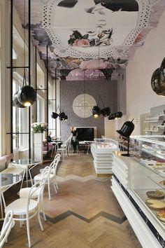 COMMERCIAL DESIGN Lolita Cafe, by Trije Arhitekti. #floor #black round pendant #white chair