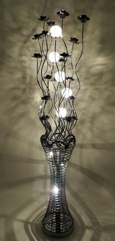 22 best black wire lamps images on pinterest black flowers flower woven wire and aluminium floor lamp in all black tall with bloomed black flowers featuring a fluted vase which is illuminated by halogen bulbs greentooth Images