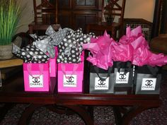 gift bags with nail polish lip stick and cute girly things for guest