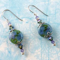 Icy Violets Artisan Lampwork Earrings with Swarovski Accents. $30.00, via Etsy.