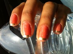 Sparkly coral golden nails