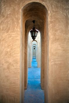 bab-al-shams-dubai. I like viewing arches through arches...like viewing a path in perspective.