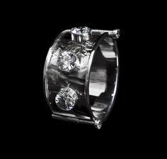 Bracelet by Horsecka Jewelry. Sterling silver, zircons.