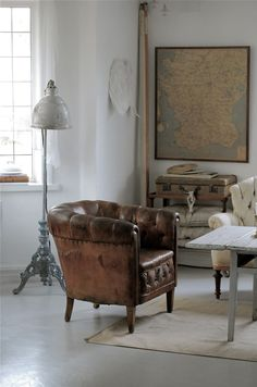 Dream Book Design: Design Inspiration Monday  --  the chair, lamp, suitcase, and framed map wall hanging