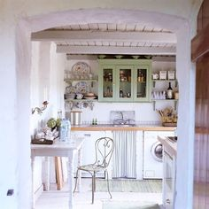 Scandinavian-style interiors can be found in this rustic cottage – there is an emphasis on a white colour palette and wooden features, including exposed beams and worktops [Photo: Getty] #cottage #cottages #cottageinterior #scandi #kitchenstorage #kitchenideas #HBBigDeclutter