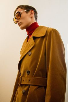 Mustard yellow coat and retro glasses backstage at Jil Sander AW15 Milan. See more here: http://www.dazeddigital.com/fashion/article/23256/1/jil-sander-aw15
