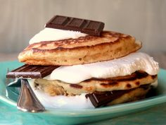 S'MORES STACKER PANCAKES~ 1 cup Original Bisquick® mix, ½ cup graham cracker crumbs, 1 egg, 1¼ cups milk, 1½ cups marshmallow creme, 4 bars (1.55 oz each) milk chocolate candy unwrapped and separated into pieces, real maple syrup.