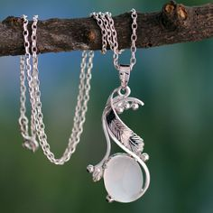 Moonstone's extravagant beauty makes this necklace design absolutely mesmerizing. Centered with the luminous gem, the pendant by India's Parul, is crafted of sterling silver and worn on a cable chain necklace.