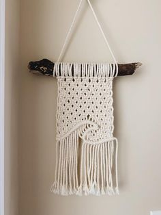 The perfect combination of beachy and bohemian!! Only beige color in stock Dimensions: (approx) -driftwood is about 10 inches -hangs down about 12-15 inches Macrame Wall Hanging Patterns, Macrame Plant Hangers, Macrame Bag, Macrame Knots, Macrame Patterns, Macrame Wall Hangings, Macrame Design, Macrame Tutorial, Macrame Projects