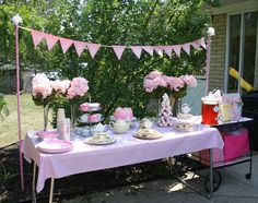 Tea party table - the banner would be super cute and super easy to do  for an outdoor party.