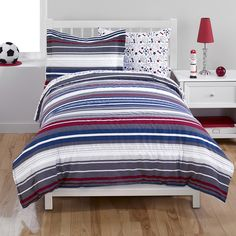 Add a dash of durable, machine washable style to any child's bedroom with this striped kids' bedding. Crafted with a plush fabric, this comforter and sham set comes in both full and twin sizes.