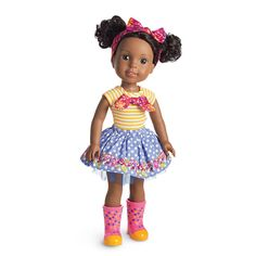 """Kendall is creative--she's always drawing and inventing. Leave it to her to patch friendly mix-ups with smiles, patience, and a handmade card. This 14.5"""" (36.8 cm) doll is sized just right for younger girls. She has deep-brown eyes and curly black hair in pigtails. Plastic/vinyl. Includes:An orange-and-white striped tee with a bold pink floral print bow<br>A light-blue skirt with white polka dots, a floral border, and blue tulle peeking out at the hem<br>A pink floral-print bow headband to…"""