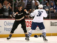 George Parros #16 of the Anaheim Ducks fights with Wade Belak #3 of the Toronto Maple Leafs