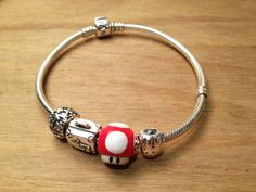Super Mario Bros Mushroom Charm to fit Pandora or similar charm bracelet. Perfect for valentines. via Etsy. Pandora Bracelets, Pandora Charms, Bracelet Charms, Super Mario Bros, Mushroom, Valentines, Charmed, Trending Outfits, Unique Jewelry
