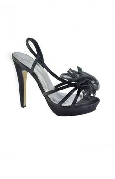 Every girl needs a fun black shoe! Great with your lbd or bridesmaid, this 4 inch heel is designed for a party! The ankle strap holds for support. This shoe is detailed with an organza flower that lies on top of the toe line. Great with short dresses!4 inches.