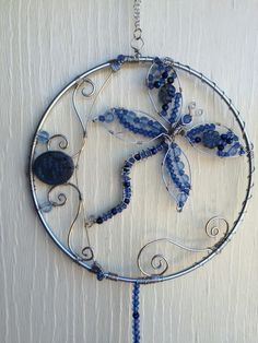 A personal favorite from my Etsy shop https://www.etsy.com/listing/252140116/dragonfly-sun-catcher-dragonflies-sun