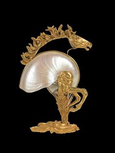 Lot : NAUTILE zoomorphe en bronze ciselé doré et partiellement argenté...Zoomorphic Nautilus shell chased gilt bronze and partially silver. Decoration depicting a galloping horse. 39 x 26 x 13 cm Ivory Elephant, Shell Decorations, Nautilus Shell, Art Premier, Found Object Art, Feather Jewelry, Seashell Art, Objet D'art, Equine Art