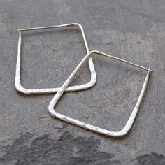 A refreshing and contemporary slant on the classic hoop earring these Hammered Square Geometric Silver Hoop Earrings are slightly hammered to give a glittering, sparkly finish. Also available in Gold vermeil. #Otisjaxon #Jewellery