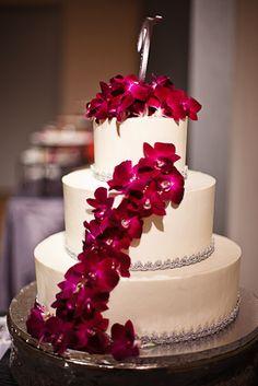 Fuschia flowers on the cake