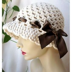 Crocheted hat with woven ribbon