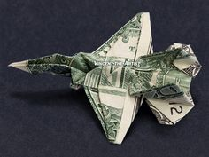 Hello, Up for sale is a beautifully crafted Origami Jet Fighter. It's made with a brand new dollar bill and the folding pattern is designed by Won Park. Origami Car, Origami Bowl, Origami Star Box, Money Origami, Origami Folding, Paper Folding, Origami Airplane, Origami Jet Fighter, Creative Money Gifts