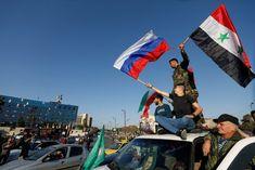 Rusia: Ataques a Siria violan el derecho internacional - Syrians wave Russian and Syrian flags during a protest against U.S.-led air strikes in Damascus,Syria April 14,2018.REUTERS/ Omar Sanadiki – RC1A0FAE5590 MOSCÚ (Reuters) – Los ataques aéreos de Estados Unidos, Reino Unido y Francia contra Siria son una violación del derecho in... - https://notiespartano.com/2018/04/14/rusia-ataques-a-siria-violan-el-derecho-internacional/