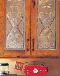 Beautiful pressed tin southwestern cabinets from Taos Tin Works.   Stylish Western Home Decorating