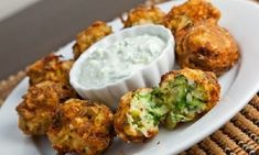 Kolokythokeftedes (Zucchini and Feta Balls) - Zucchini, feta and plenty of fresh herbs rolled into balls and fried until light and crispy and golden brown. For Low Carb use favorite flour, breadcrumbs substitute - Serve with tzatziki or marinara sauce Vegetarian Recipes, Cooking Recipes, Healthy Recipes, Greek Food Recipes, Healthy Food, Cooking Ribs, Amish Recipes, Top Recipes, Veggie Recipes