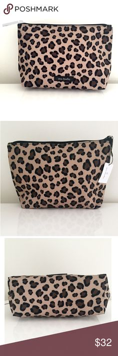 "🎉HP🎉NWT Vera Bradley Leopard Large Cosmetic Bag 🎉HOST PICK🎉:NWT Vera Bradley large 'Lighten Up' cosmetic case/bag in leopard print. Tan case w/ brown leopard spots outlined in black. Zipper closure. Lightweight, water resistant & durable. Everything you look for in a makeup bag! 6-1/2""H x 10-1/2""W x 3""D Vera Bradley Bags Cosmetic Bags & Cases"