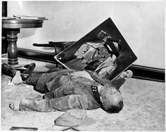 """""""With a torn picture of his """"Führer"""" beside his clenched fist, a general of the Volkssturm, Hitler's last-stand home defense forces, lies dead on the floor of city hall in Leipzig, April He committed suicide rather than face the U. Dramatic Photos, Foto Real, Picture Albums, The Third Reich, German Army, German Men, World History, Ww2 History, Military History"""