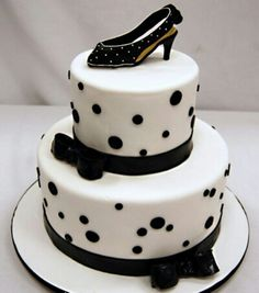2 Tier White cake with black accents and black high heal!
