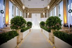 Ceremony at the Mellon in DC with boxwood and greenery and lots of white.