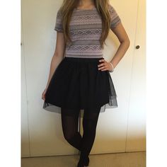 Short Black Skirt Super cute black skirt. It's a size medium but fits like a small. It's short and very flattering. Looks great with just about anything! B-wear Bottoms Skirts