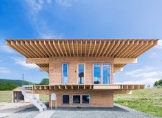 jun igarashi tops japanese residence with an oversized hat roof