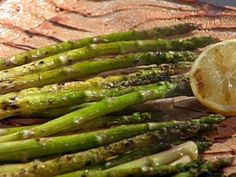 Grilled Asparagus with Lemon and Olive Oil recipe from Emeril Lagasse via Food Network