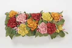 Floral Cushion-A cushion covered in gorgeous blooms! wool, hand dyed and hand felted into free-forming flower petals by Ronel Jordaan. Flower Petals, Flowers, Floral Cushions, Textile Design, Fiber Art, Floral Wreath, Bloom, Textiles, Shapes