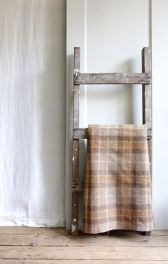 store blankets on a ladder to save space... So easy and youcan make your own ladder!
