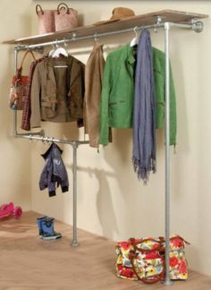 with coat hangers on steel rails from scaffolding.vestibule with coat hangers on steel rails from scaffolding. Homemade Furniture, Diy Furniture, Diy Rack, Closet Layout, Wardrobe Design, Closet Bedroom, Wooden Shelves, Walk In Closet, Scaffolding