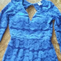 Blue lace Romper Super sexy royal blue lace romper in excellent condition with no stains or holes... never even worn! Women's size medium. 95% polyester  5% spandex so there is stretch to it! Shop WTD Pants Jumpsuits & Rompers