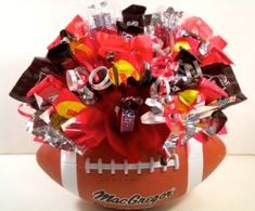 Football Centerpiece - This would be great for a Wedding if there was flowers in it
