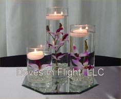 feather and glass center piece | Chair Covers of Lansing: Centerpieces and Florals