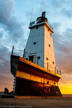 The white pyramid shaped tower known as the Ludington Lighthouse, is a beacon of light on the coast of Michigan. Lighthouse Pictures, Lake Michigan, Ludington Michigan, Michigan Usa, Beacon Of Light, Architecture, Scenery, Around The Worlds, Instagram