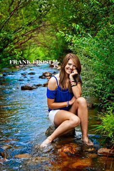 like the pose itself and like how the picture is in a lake and also like that she is sitting on a stump.